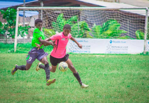 Photo: A San Juan Jabloteh player (right) tries to hold off an opponent during 2015 Republic Bank National Youth Cup quarterfinal action. (Courtesy Amigo Garraway/Republic Bank)