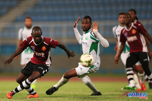 """Photo: North East Stars striker Gorean """"Ratty"""" Highley (left) takes on W Connection defender Christian Ocoro Viveros in the 2015 TTFA FA Trophy final. Highley was on the scoresheet last night against Siparia Spurs in the Toyota Classic Cup. (Courtesy Allan V Crane/Wired868)"""