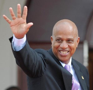 The Prime Minister of Belize, Dean Barrow (L), waves on his arrival for a retreat for heads of state at the Diplomatic Centre during the 5th Summit of the Americas in Port-of-Spain, Trinidad and Tobago, on April 19, 2009. US President Barack Obama will return home Sunday from his first Americas summit hopeful he has opened a new era in relations with leaders of the continent.  AFP PHOTO /YURI CORTEZ (Photo credit should read YURI CORTEZ/AFP/Getty Images)