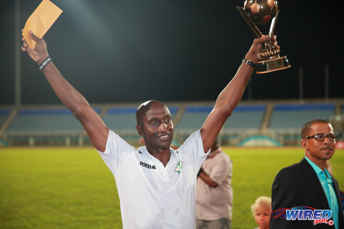 Photo: San Juan Jabloteh coach Keith Jeffrey (left) celebrates with the Best Coach trophy from the 2014 Toyota Classic competition. Looking on is Pro League CEO Dexter Skeene. (Courtesy Allan V Crane/Wired868)