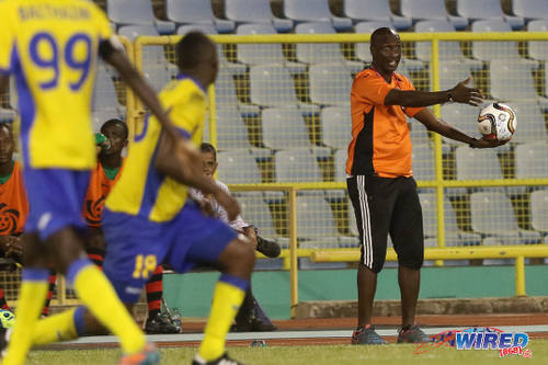 Photo: San Juan Jabloteh coach Keith Jeffrey (right) offers encouragement to his troops during their First Citizens Cup loss to Defence Force last night. (Courtesy Chevaughn Christopher/Wired868)