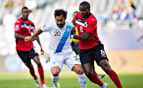 Photo: Trinidad and Tobago midfielder Khaleem Hyland (right) tackles Guatemala captain Carlos Ruiz in 2015 CONCACAF Gold Cup action. (Courtesy CONCACAF)
